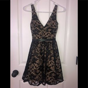 Tan and black v-neck lace homecoming dress